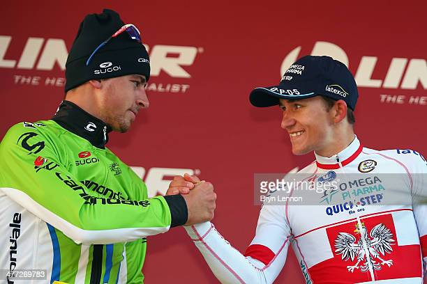Second placed Peter Sagan of Slovakia and Cannondale shakes hands with race winner Michal Kwiatkowski of Poland and Omega PharmaQuickStep on the...