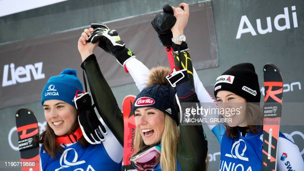 Second placed Petra Vlhova of Slovakia winner Mikaela Shiffrin of the US and third placed Michelle Gisin of Switzerland pose on the podium after the...