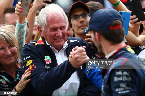 Second placed Pierre Gasly of France and Scuderia Toro Rosso celebrates in parc ferme with Red Bull Racing Team Consultant Dr Helmut Marko during the...