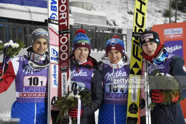 Second placed Poland's Dawid Kubacki Kamil Stoch Stefan Hula and Maciej Kot pose after the ski jumping team competition HS130 of the FIS World Cup in...