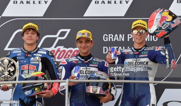 Second placed Redox PrustelGP Italian rider Marco Bezzecchi first placed Del Conca Gresini Moto3 team Spanish rider Jorge Martin and third placed Del...