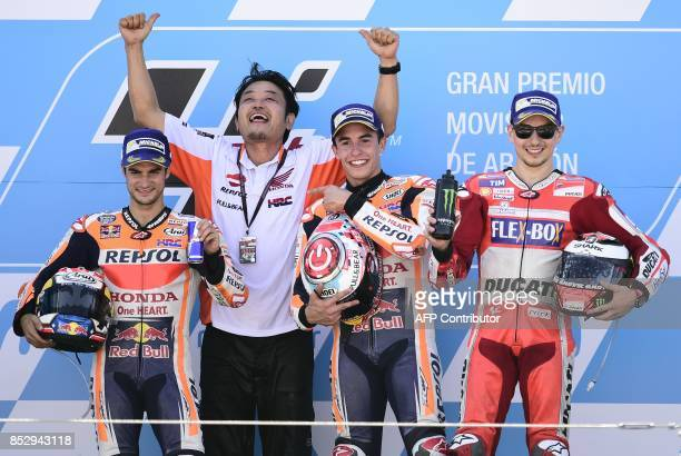 Second placed Repsol Honda Team's Spanish rider Dani Pedrosa, Repsol team member Katsuya Shibasaki, winner Repsol Honda Team's Spanish rider Marc...