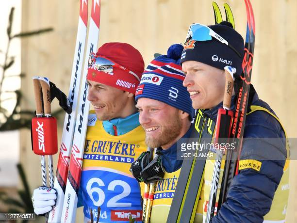 Second placed Russia's Alexander Bessmertnykh winner Norway's Martin Johnsrud Sundby and third placed Finland's Iivo Niskanen pose after the Men's...