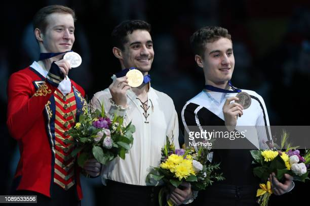 Second placed Russia's Alexander Samarin winner Spain's Javier Fernandez and third placed Italy's Matteo Rizzo during podium ceremony after the Men...