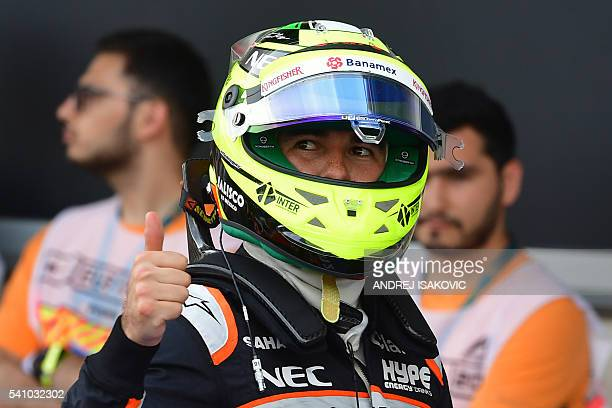 Second placed Sahara Force India F1 Team's Mexican driver Sergio Perez celebrates after the qualifying session of the European Formula One Grand Prix...