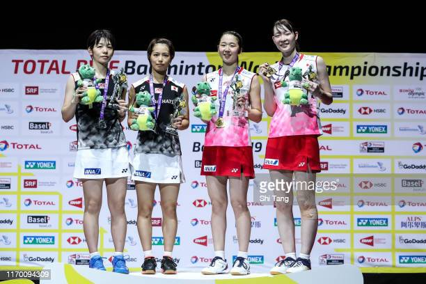 Second placed Sayaka Hirota and Yuki Fukushima champion Wakana Nagahara and Mayu Matsumoto of Japan pose with their medals on the podium for the...