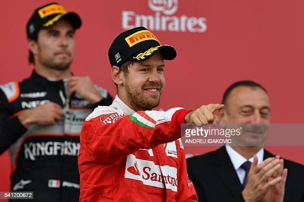 Second placed Scuderia Ferrari's German driver Sebastian Vettel celebrates next to third placed Sahara Force India F1 Team's Mexican driver Sergio...