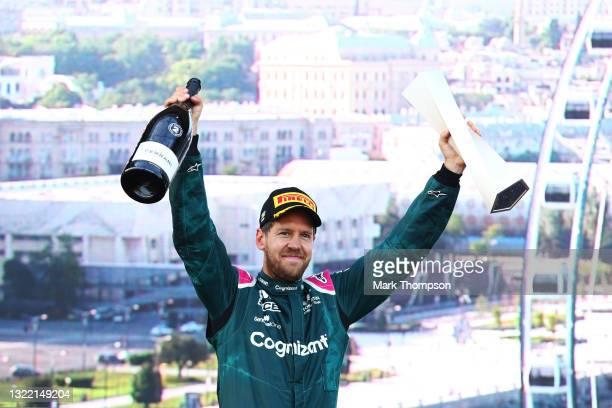 Second placed Sebastian Vettel of Germany and Aston Martin F1 Team celebrates on the podium during the F1 Grand Prix of Azerbaijan at Baku City...