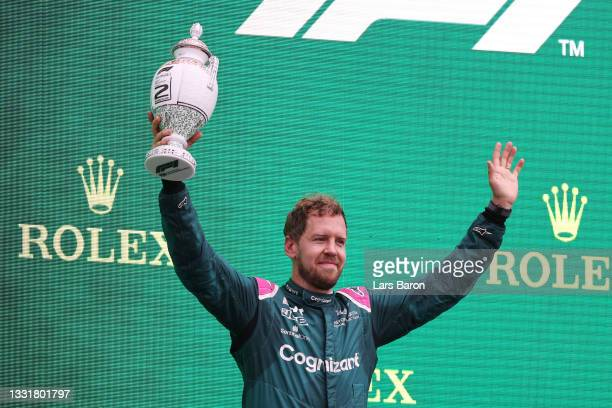 Second placed Sebastian Vettel of Germany and Aston Martin F1 Team celebrates on the podium during the F1 Grand Prix of Hungary at Hungaroring on...