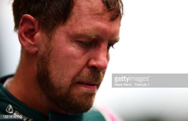 Second placed Sebastian Vettel of Germany and Aston Martin F1 Team looks on in parc ferme during the F1 Grand Prix of Hungary at Hungaroring on...