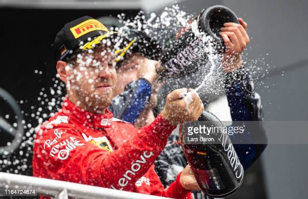 Second placed Sebastian Vettel of Germany and Ferrari celebrates on the podium during the F1 Grand Prix of Germany at Hockenheimring on July 28 2019...