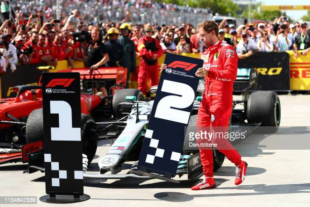 Second placed Sebastian Vettel of Germany and Ferrari swaps the number boards at parc ferme during the F1 Grand Prix of Canada at Circuit Gilles...