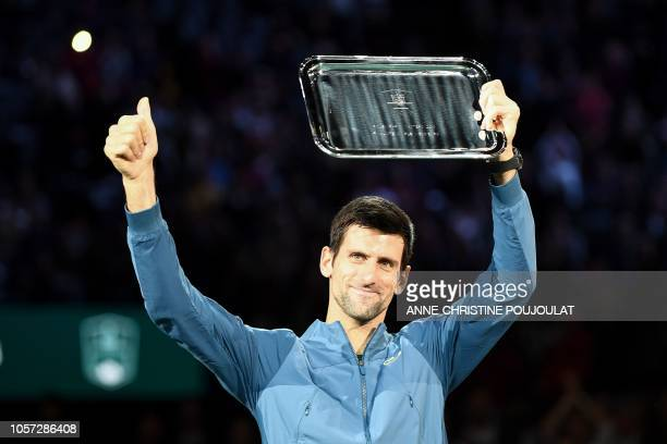 Second placed Serbia's Novak Djokovic poses with his trophy after the men's singles final tennis match against Russia's Karen Khachanov, on day seven...