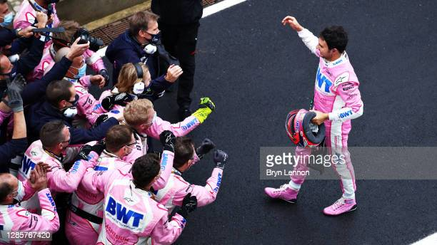 Second placed Sergio Perez of Mexico and Racing Point celebrates with his team in parc ferme during the F1 Grand Prix of Turkey at Intercity Istanbul...