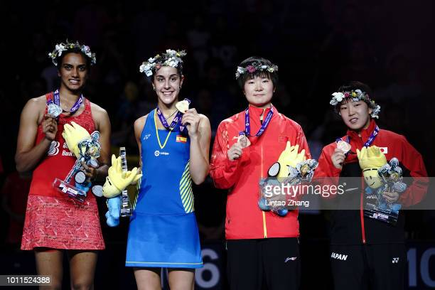 Second placed Sindhu Pusarla of India champion Carolina Marin of Spain and thirdplaced He Bingjiao of China and Akane Yamaguchi of Japan chat on the...