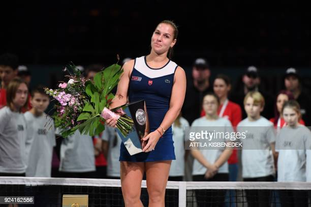 Second placed Slovakia's Dominika Cibulkova celebrates with her trophy after her final match of the WTA Hungarian Open Ladies' tennis tournament...