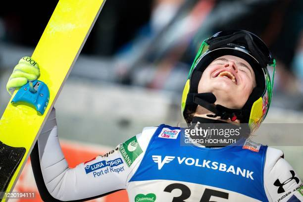 Second placed Slovenia's Nika Kriznar reacts in the finish area after the Women's Normal Hill Individual Ski Jumping event of the FIS Ski Jumping...