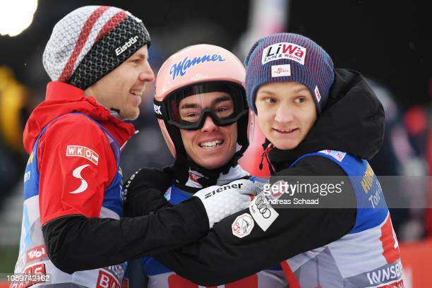 Second placed Stefan Kraft of Austria celebrates with his team mates Michael Hayboeck and Daniel Huber on day 6 of the 67th FIS Nordic World Cup Four...