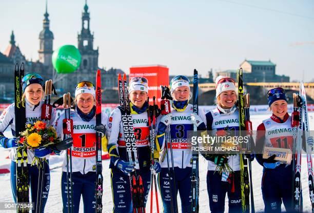 Second placed Stina Nilsson Hanna Falk of team Sweden I winner Ida Ingemarsdotter Maja Dahlqvist of team Sweden II third placed Sophie Caldwell and...
