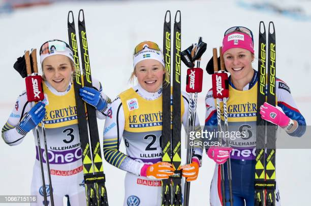 Second placed Stina Nilsson of Sweden winner Jonna Sundling of Sweden and third placed Sadie Bjornsen of the US pose after the women´s Cross Country...