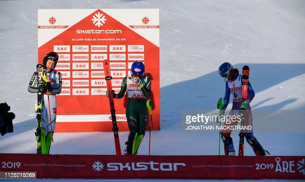 Second placed Sweden's Anna Swenn Larsson and third placed Slovakia's Petra Vlhova look on as US' Mikaela Shiffrin reacts after winning the women's...