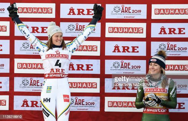 Second placed Sweden's Anna Swenn Larsson celebrates next to US' Mikaela Shiffrin during the flower ceremony of the women's slalom event at the 2019...