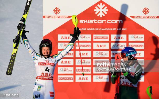 Second placed Sweden's Anna Swenn Larsson is applauded by winner US' Mikaela Shiffrin after the women's slalom event at the 2019 FIS Alpine Ski World...