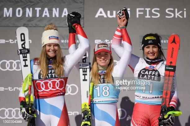 Second placed Switzerland's Corinne Suter winner Switzerland's Lara GutBehrami and third placed Austria's Stephanie Venier pose during the podium...