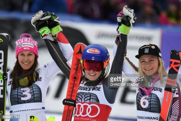 Second placed, Switzerland's Wendy Holdener, winner US Mikaela Shiffrin and Sweden's Frida Hansdotter celebrate after the FIS World Cup Women's...