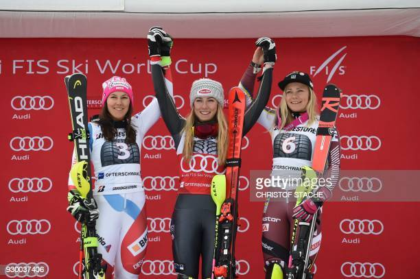 Second placed Switzerland's Wendy Holdener winner US Mikaela Shiffrin and Sweden's Frida Hansdotter pose on the podium after the FIS World Cup...