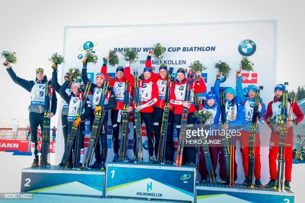 Second placed team Austria with Julian Eberhard Simon Eder Felix Leitner and Dominik Landertinger winners from Norway Johannes Thingnes Boe Tarjei...