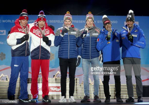 Second placed team from Russia Gleb Retivykh and Alexander Bolshunov winning team from Norway Emil Iversen Johannes Hoesflot Klaebo and third placed...