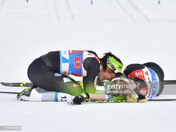Second placed team Katja Visnar and Anamarija Lampic from Slovenia celebrate after taking the silver medal in the women's team sprint final of the...