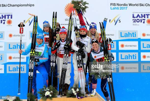 Second placed team of Russia Natalia Matveeva and Yulia Belorukova winner team of Norway Maiken Caspersen Falla and Heidi Weng and third placed team...