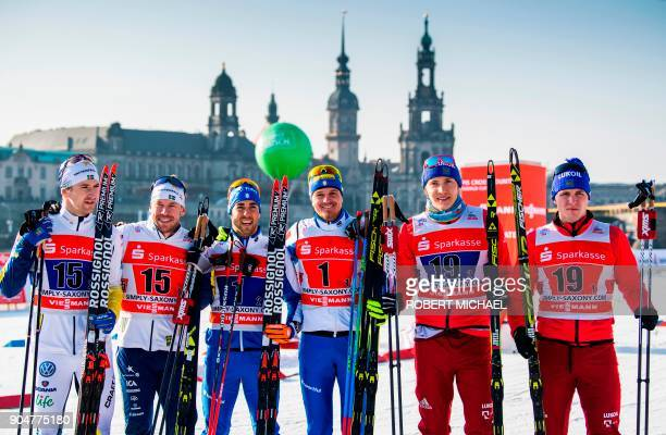 Second placed Teodor Peterson Emil Joensson of team Sweden I winner Federico Pellegrino Dietmar Noeckler of team Italy I and third placed Gleb...