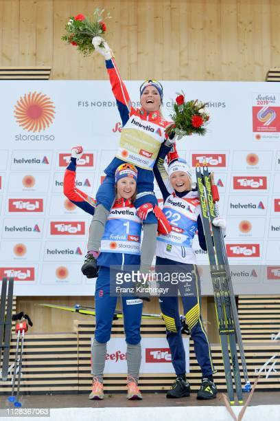 Second placed Therese Johaug of Norway first placed Ingvild Flugstad Ostberg of Norway and third placed Frida Karlsson of Sweden pose on the podium...