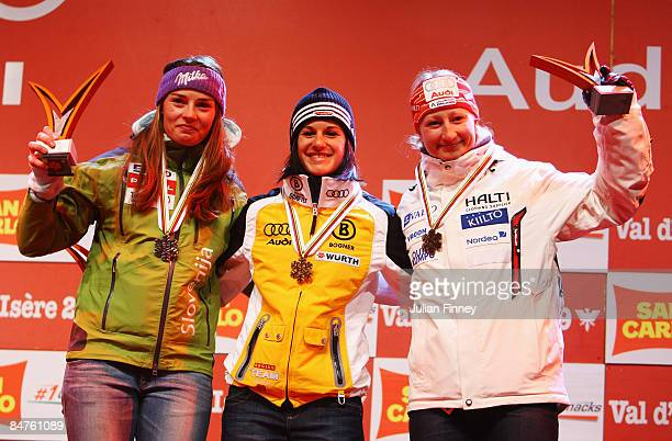 12 Second placed Tina Maze of Slovenia race winner Kathrin Hoelzl of Germany and third placed Tanja Poutiainen of Finland celebrate at the Medal...