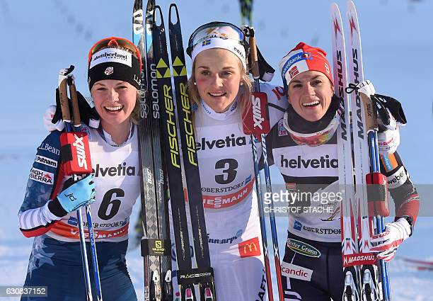 Second placed US Jessica Diggins, winner Swedish Stina Nilsson and third placed Norwegian Heidi Weng pose after the ladies 5 kilometer skiathlon...