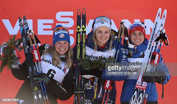 Second placed US Jessica Diggins, winner Swedish Stina Nilsson and third placed Norwegian Heidi Weng pose during the winner ceremony on the podium of...