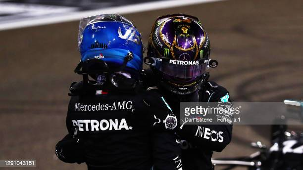 Second placed Valtteri Bottas of Finland and Mercedes GP and third placed Lewis Hamilton of Great Britain and Mercedes GP hug in parc ferme during...