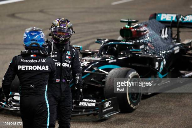 Second placed Valtteri Bottas of Finland and Mercedes GP and third placed Lewis Hamilton of Great Britain and Mercedes GP talk in parc ferme during...