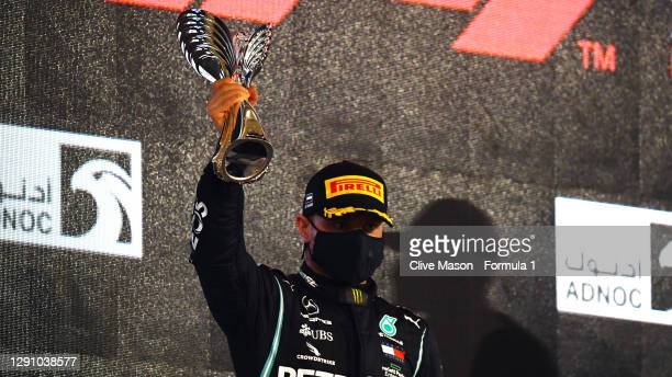Second placed Valtteri Bottas of Finland and Mercedes GP celebrates on the podium during the F1 Grand Prix of Abu Dhabi at Yas Marina Circuit on...