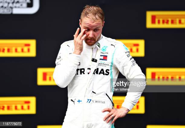 Second placed Valtteri Bottas of Finland and Mercedes GP looks dejected in parc ferme during the F1 Grand Prix of France at Circuit Paul Ricard on...