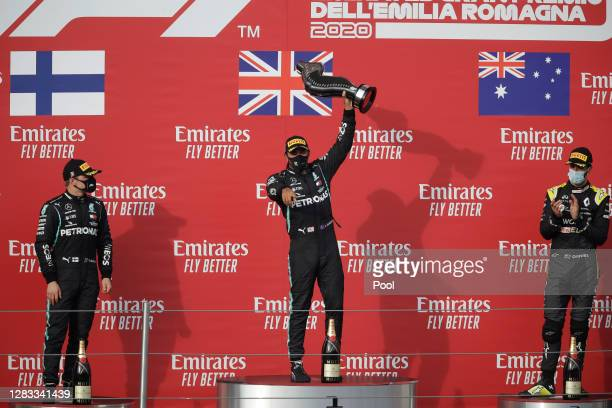 Second placed Valtteri Bottas of Finland and Mercedes GP, race winner Lewis Hamilton of Great Britain and Mercedes GP and third placed Daniel...