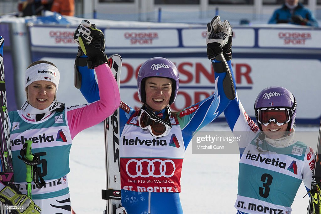 Second placed Viktoria Rebensburg, (L) winner Tina Maze of Slovenia (C) and 3rd place Tessa Worley of France pose after the Audi FIS Alpine Ski World Giant Slalom race on December 9 2012 in St Moritz, Switzerland.