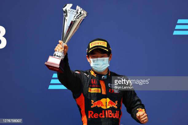 Second placed Yuki Tsunoda of Japan and Carlin celebrates on the podium during the Formula 2 Championship Feature Race at Sochi Autodrom on September...