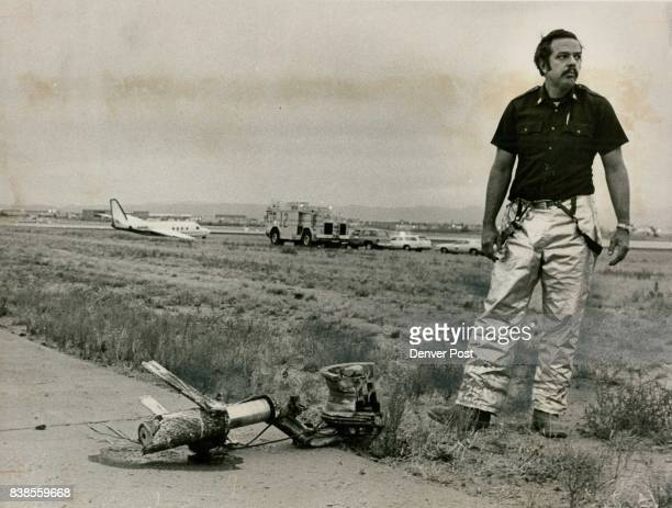 Second Plane Leaves Runway After Blowout Capt Eldon Buller of the Denver fire Department stands by a landing gear from Jet Commander background after...