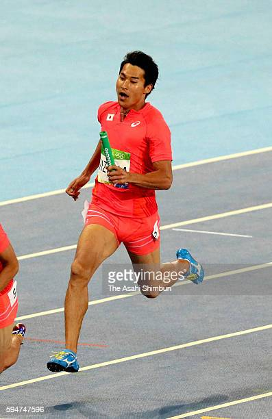 Second runner Shota Iizuka of Japan competes in the Men's 4x100m Relay final on day 14 of the Rio 2016 Olympic Games at Olympic Stadium on August 19...