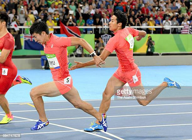 Second runner Shota Iizuka of Japan passes the baton to third runner Yoshihide Kriyu in the Men's 4x100m Relay final on day 14 of the Rio 2016...