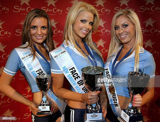 Second runner-up Laura Love, winner Rachel Burr and 1st runner-up Nikki Walton pose during the 'Face of Origin' competition at Star City on June 24,...